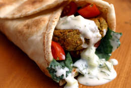 ** FOR USE WITH AP WEEKLY FEATURES **   The main course for a Greek-style vegetarian meal consists of a combination of falafel, strongly seasoned fried patties made from ground chickpeas, wrapped in a bed of greens and pita bread and doused with tzatziki yogurt sauce.  (AP Photo/Larry Crowe)