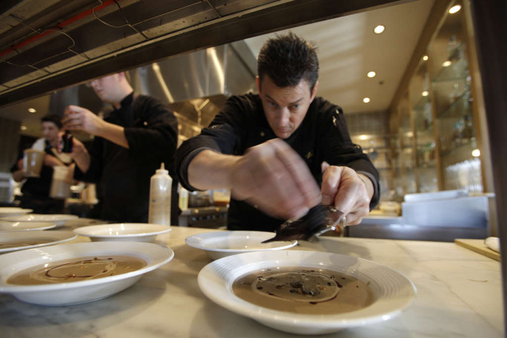 Chef Ken Frank shaves Burgundy black truffles onto a mushroom soup  at his La Toque restaurant during the inaugural Napa Truffle Festival in Napa, Calif., Saturday, Dec. 11, 2010. The three-day event combined some the best chefs and truffle scientists to showcase truffles which have been treasured for centuries. Soon, chefs in North America will be able to get black truffles farm-to-kitchen in a matter of hours, instead of days as is the case currently with imported European truffles. (AP Photo/Eric Risberg)