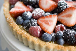 This March 14, 2011 photo shows a coconut and berry Passover tart in Concord, N.H. This tart sports a coconut crust that is both chewy and crispy, a pudding-like vanilla-almond filling and mounds of fresh fruit.    (AP Photo/Matthew Mead)