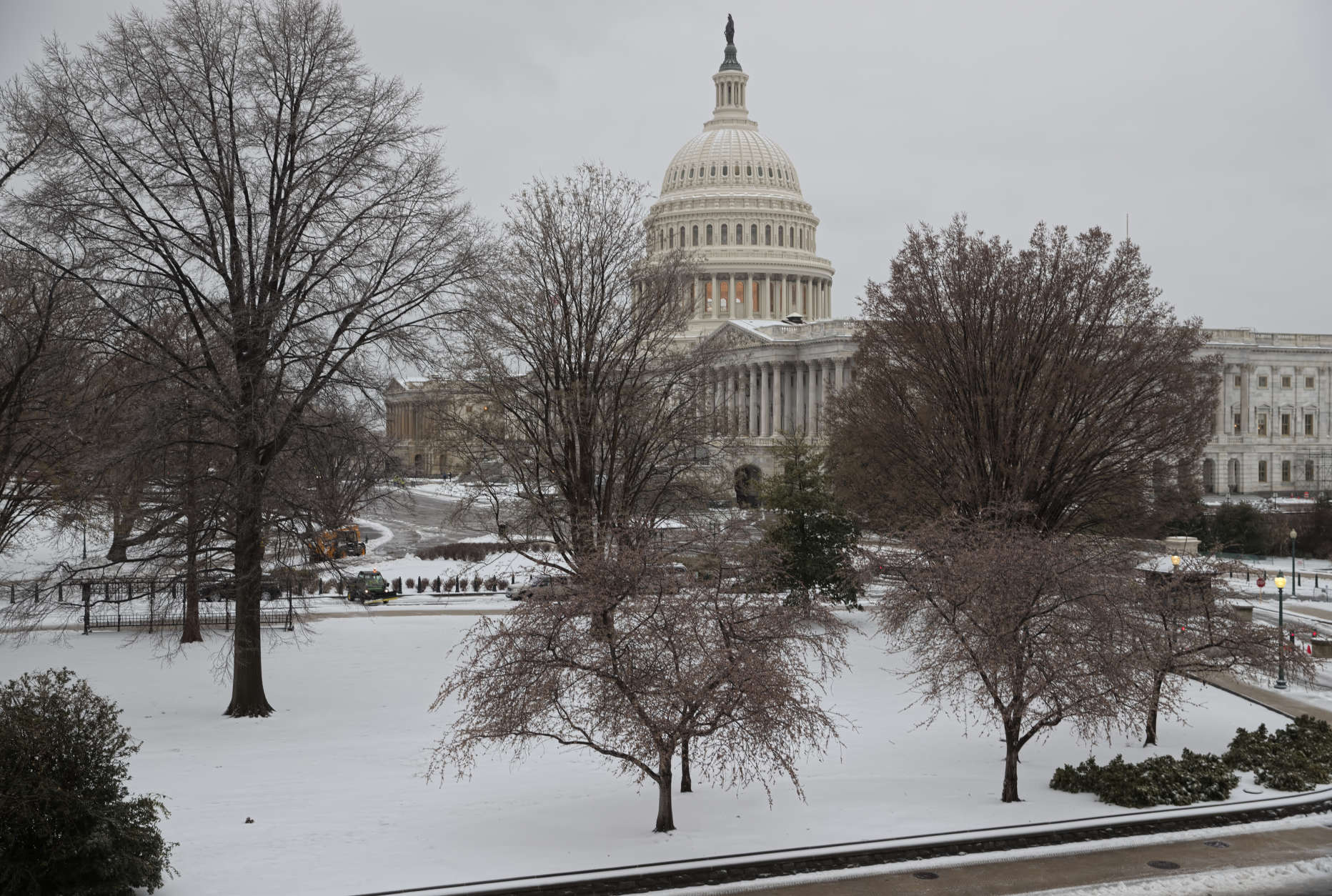 Snow covers Capitol Hill in Washington, early Tuesday, March, 14, 2017. A late-season storm is dumping a messy mix of snow, sleet and rain on the mid-Atlantic, complicating travel, knocking out power and closing schools and government offices around the region. (AP Photo/J. Scott Applewhite)