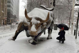 "The ""Charging Bull"" statue is covered in snow in New York's Financial District, Tuesday, March 14, 2017. New York Gov. Andrew Cuomo has declared a state of emergency Tuesday for all of New York's 62 counties, including New York City's five boroughs. (AP Photo/Richard Drew)"