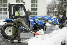 Workers clear snow outside the West Wing of the White House in Washington, Tuesday, March 14, 2017. A sloppy, blustery late-season storm lashed the Northeast with sleet and more than a foot of snow in places, paralyzing much of the Washington-to-Boston corridor after a remarkably mild February had lulled people into thinking the worst of winter was over. (AP Photo/Andrew Harnik)