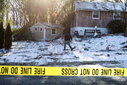 Montgomery County, Md. Police officers mark evidence near a house after an explosion in Rockville, Md., Friday, March 17, 2017. A house in a Maryland suburb of the nation's capital was leveled early Friday by a thunderous explosion heard for miles around, the blast shattering windows and causing other damage to several neighboring homes, authorities said. (AP Photo/Jose Luis Magana)