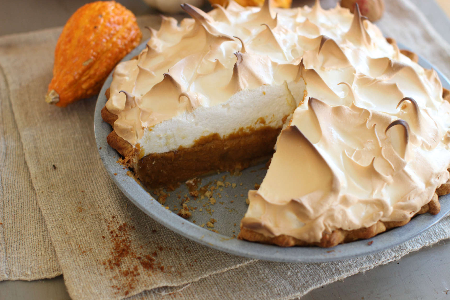 This Oct. 12, 2015 photo shows citrus pumpkin meringue pie in Concord, NH. This Thanksgiving pie is deliciously deceptive, hidden under the meringue is a classic pumpkin pie spiked with just a hint of citrus. (AP Photo/Matthew Mead)