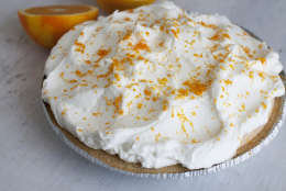 This July 21, 2014 photo shows orange-vanilla ice cream pie with orange whipped cream in Concord, N.H. The dish offers the creamy-sweet richness of a Creamsicle. (AP Photo/Matthew Mead)