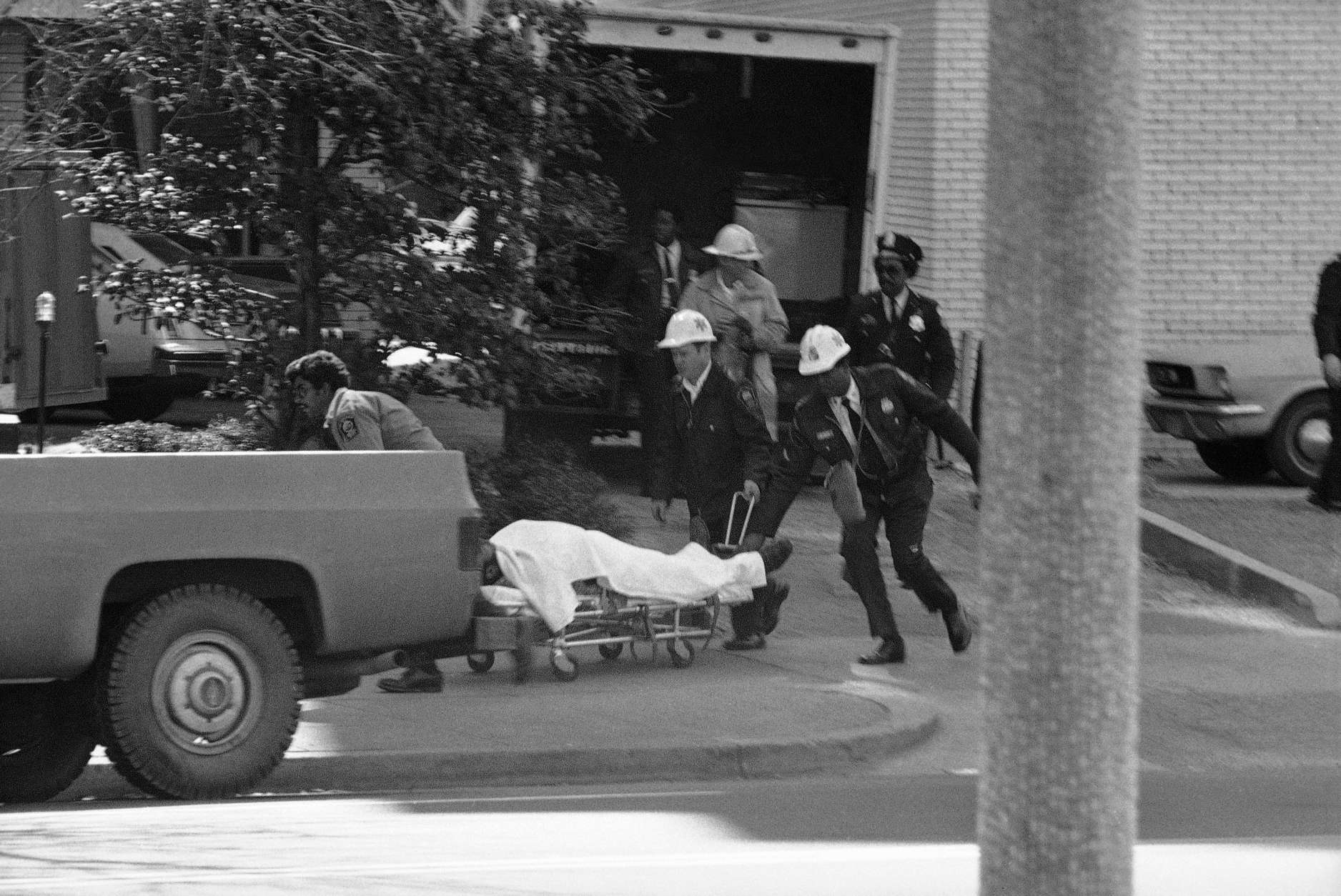 Rescue workers remove an injured person from B'Nai B'Rith is Washington on Wednesday, March 9, 1977. Armed gunmen are holding hostages inside the building, one of three locations in the nation's capital where hostages have been taken. (AP Photo)
