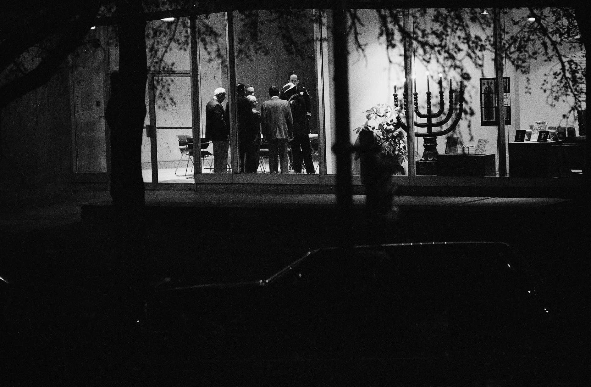 Three ambassadors and others confer in the first floor area of Bnai Brith International headquarters where gunmen are holding hostages upstairs, Thursday, March 10, 1977, Washington, D.C. (AP Photo)