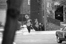 Heavily armed police wearing protective vests arrive at their post near the Islamic center in Northwest Washington on Thursday, March 10, 1977 to relieve others who had been on duty all night watching the center where gunmen held hostages. It is one of three buildings in the capital where armed terrorists, believed to be members of the Hanafi Muslim sect, were holding hostages. (AP Photo)