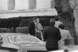 A woman identified as Cecile B. Von Goetz is led away from the Islamic Center in Washington on Thursday, March 10, 1977 following her release. Terrorists have taken over the center and are holding hostages. (AP Photo)