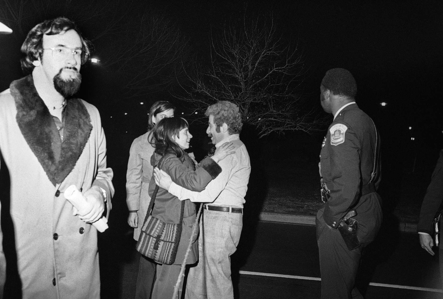 A man spots and embraces a woman who was among several hostages sent to George Washington hospital following their release by gunmen in Washington on Friday, March 11, 1977. The terrorists held up to 135 persons in three different buildings. (AP Photo)
