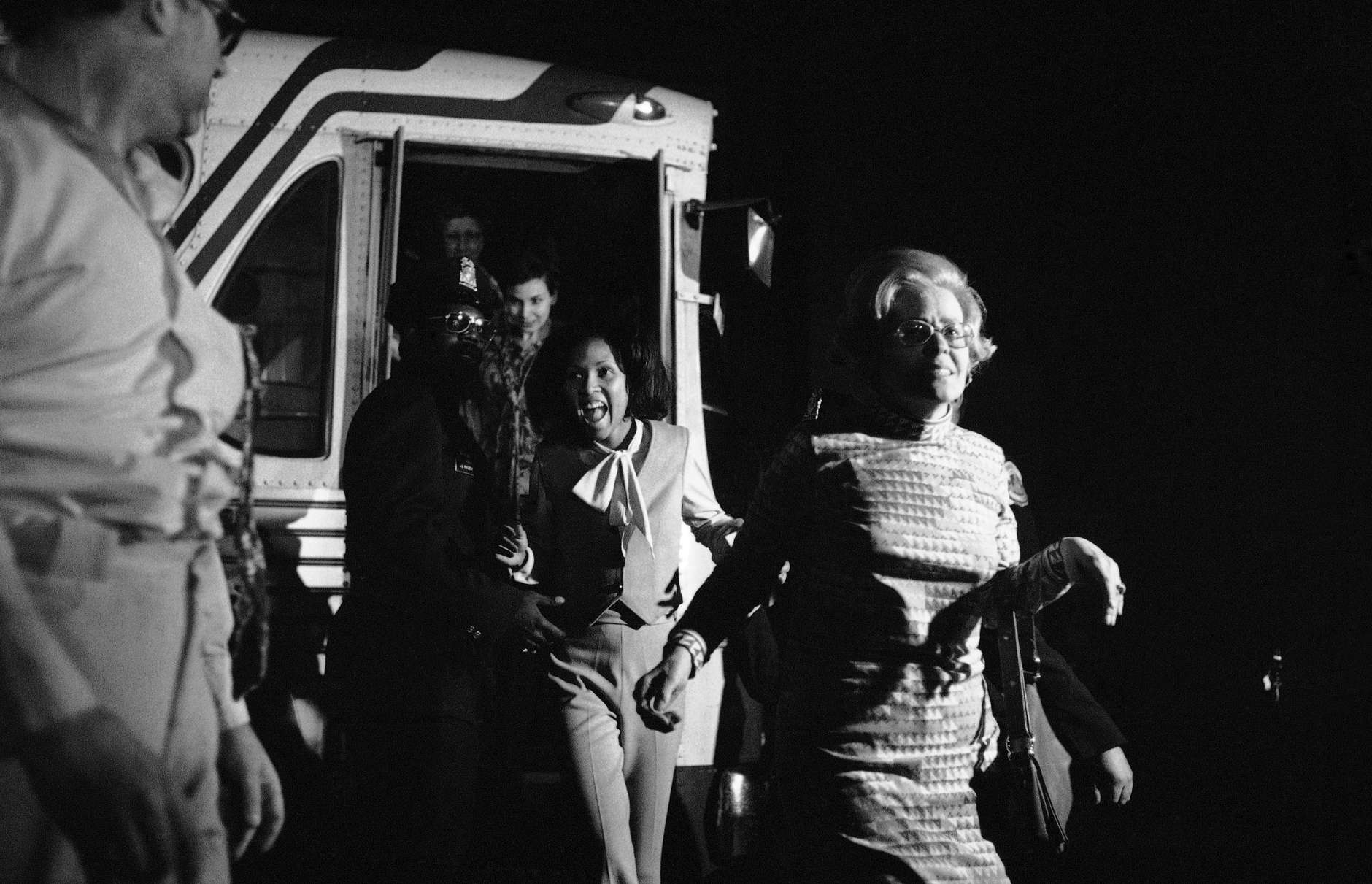 An unidentified woman jumps off a bus at the Foundry Methodist Church in Washington, D.C., on Friday, March 11, 1977 following her release by gunmen. Twelve black Hanafi Moslems held some 134 hostages in three Washington buildings for 38 hours before surrendering to police on Friday. (AP Photo)