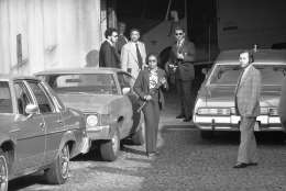 Armed police officers stand by outside Superior Court in Washington on Friday, March 11, 1977 as Hanafi Muslims arrive for asrraignment. The group held hostages in three locations in the nation's capital. (AP Photo)