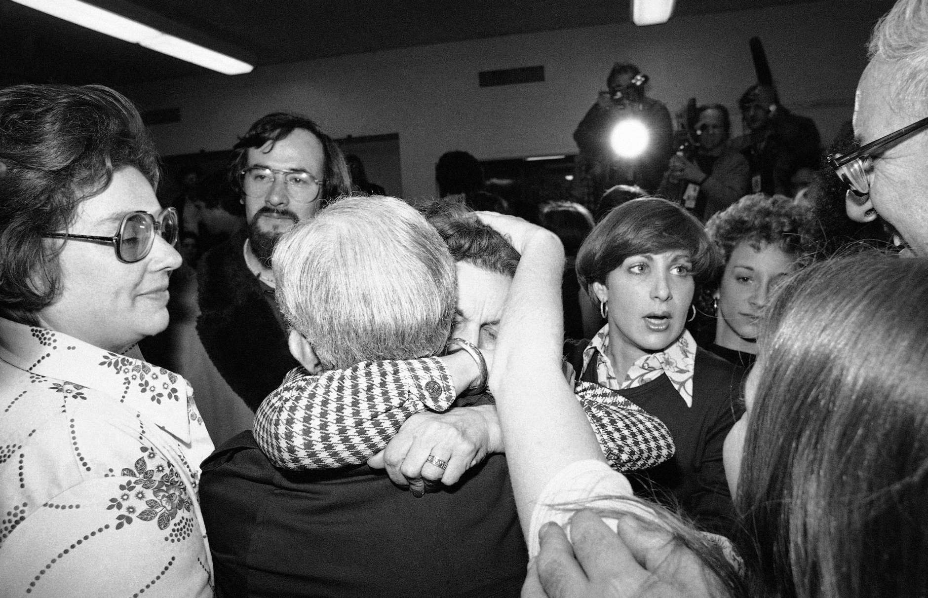 Relatives and friends are reunited at Washington's Foundry Methodist Church on Friday, March 11, 1977 after hostages were released by terrorists who had held them in three buildings since Wednesday. (AP Photo)