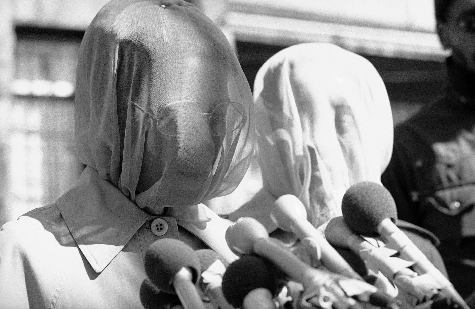 Veiled Begum Khadyja, left, wife of the Hanafi Muslim sect leader, Hamaas Abdul Khaalis, reads a statement to reporters in Washington on Thursday, March 17, 1977 in answer to a statement made by Rabbi Meir Kahane of the Jewish Defense League. Kahane said his JDL will mass in front of the Washington headquarters of the Hanafis and challenge them to fight. The Hanafi warned the JDL 'that they will write their epitaph in self-destruction and the blood of their people. Woman at right is unidentified. (AP Photo)