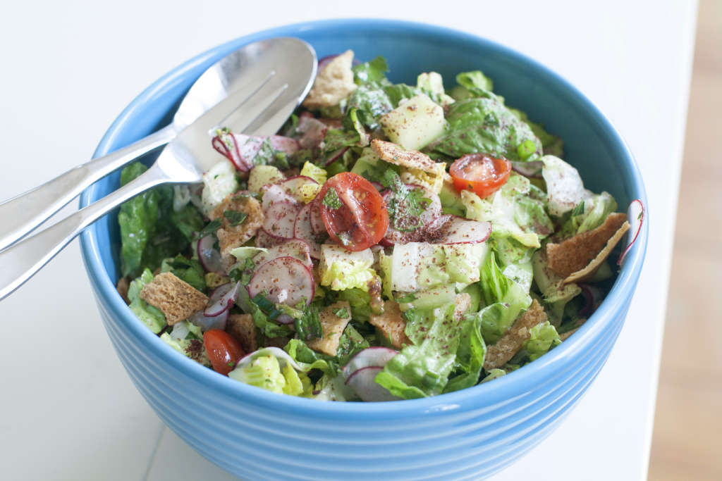 This April 14, 2014, photo shows fattoush, a salad with pita crumble in Concord, N.H. (AP Photo/Matthew Mead)