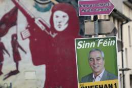 A Sinn Fein poster in West Belfast, Northern Ireland, Thursday, March 2, 2017. Voting has begun Thursday in the British province of Northern Ireland to elect a new Stormont Assembly after the power-sharing government collapsed in January. (AP Photo/Peter Morrison)