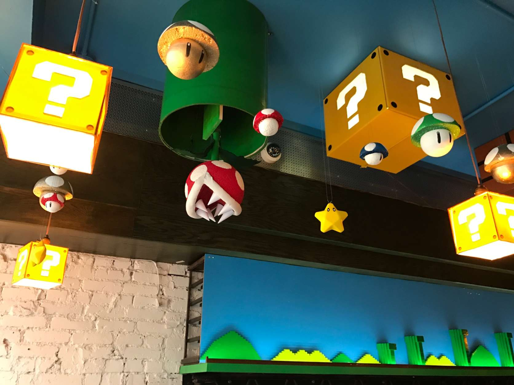 "At Mockingbird Hill, red and white ""piranha plants"" drop down from green pipes and boxes marked with question marks light up. A cheerful voice that says, ""It's me! Mario!"" comes over the speaker.  (WTOP/Rachel Nania)"