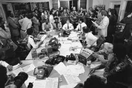 Then-District of Columbia Mayor Walter Washington stands center surrounded by newsmen inside the emergency command post in Washington on Thursday, March 10, 1977, where they were monitoring the hostage situation. (AP Photo/Harvey Georges)