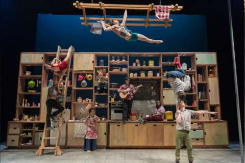Omelets and acrobats flip in hybrid circus-cooking show