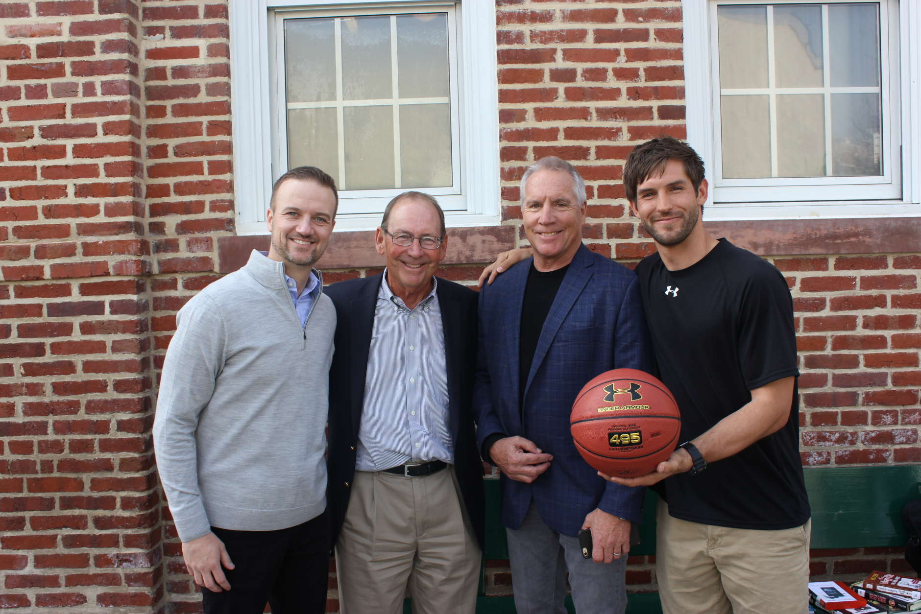 President of Under Armour North America  Jason La Rose; Founder/President of PHIT America  Jim Baugh; PHIT America Marketing Director Doug Gordon; and Ross Elementary PE teacher Jason Shegda. Shegda is holding an Under Armour basketball, which is the initial gift to the school. (Courtesy of Shari Gordon)
