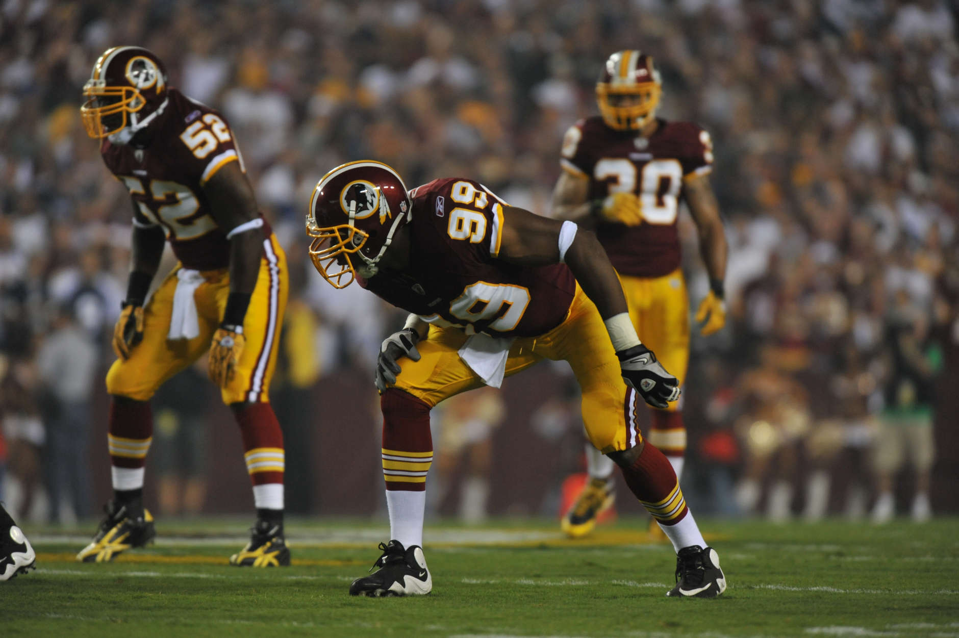 LANDOVER - SEPTEMBER 12:  Andre Carter #99 of the Washington Redskins defends during the NFL season opener against the Dallas Cowboys at FedExField on September 12, 2010 in Landover, Maryland. The Redskins defeated the Cowboys 13-7. (Photo by Larry French/Getty Images)