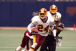 30 Dec 2001: Champ Bailey #24 of the Washington Redskins is chased by Joe Horn #87 of the New Orleans Saints during the game at the Superdome in New Orleans, Louisiana. The Redskins won 40-10. DIGITAL IMAGE. Mandatory Credit : Harry How/Getty Images