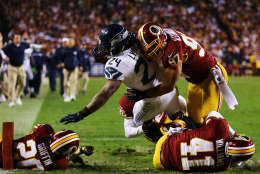 LANDOVER, MD - JANUARY 06:  Marshawn Lynch #24 of the Seattle Seahawks scores a fourth quarter touchdown against the defense of  Lorenzo Alexander #97 of the Washington Redskins during the NFC Wild Card Playoff Game at FedExField on January 6, 2013 in Landover, Maryland.  (Photo by Al Bello/Getty Images)