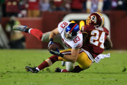 LANDOVER, MD - DECEMBER 01: Tight end Brandon Myers #83 of the New York Giants is tackled by strong safety Bacarri Rambo #24 of the Washington Redskins after catching a fourth quarter pass during the Giants 24-17 win at FedExField on December 1, 2013 in Landover, Maryland.  (Photo by Rob Carr/Getty Images)