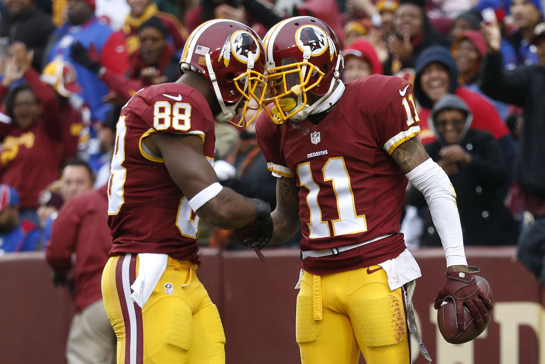 LANDOVER, MD - NOVEMBER 29: Wide receiver DeSean Jackson #11 of the Washington Redskins celebrates with wide receiver Pierre Garcon #88 of the Washington Redskins after scoring a second quarter touchdown against the New York Giants at FedExField on November 29, 2015 in Landover, Maryland. (Photo by Rob Carr/Getty Images)