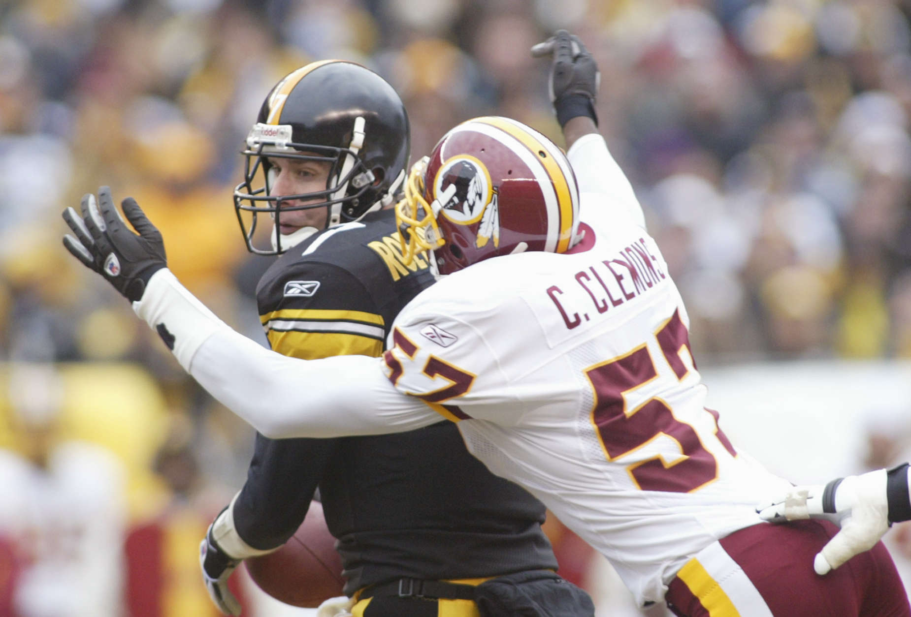 PITTSBURGH - NOVEMBER 28:  Quarterback Ben Roethlisberger #7 of the Pittsburgh Steelers is sacked by linebacker Chris Clemons #57 of the Washington Redskins during the game on November 28, 2004 at Heinz Field in Pittsburgh, Pennsylvania. The Steelers defeated the Redskins 16-7. (Photo by Rick Stewart/Getty Images)