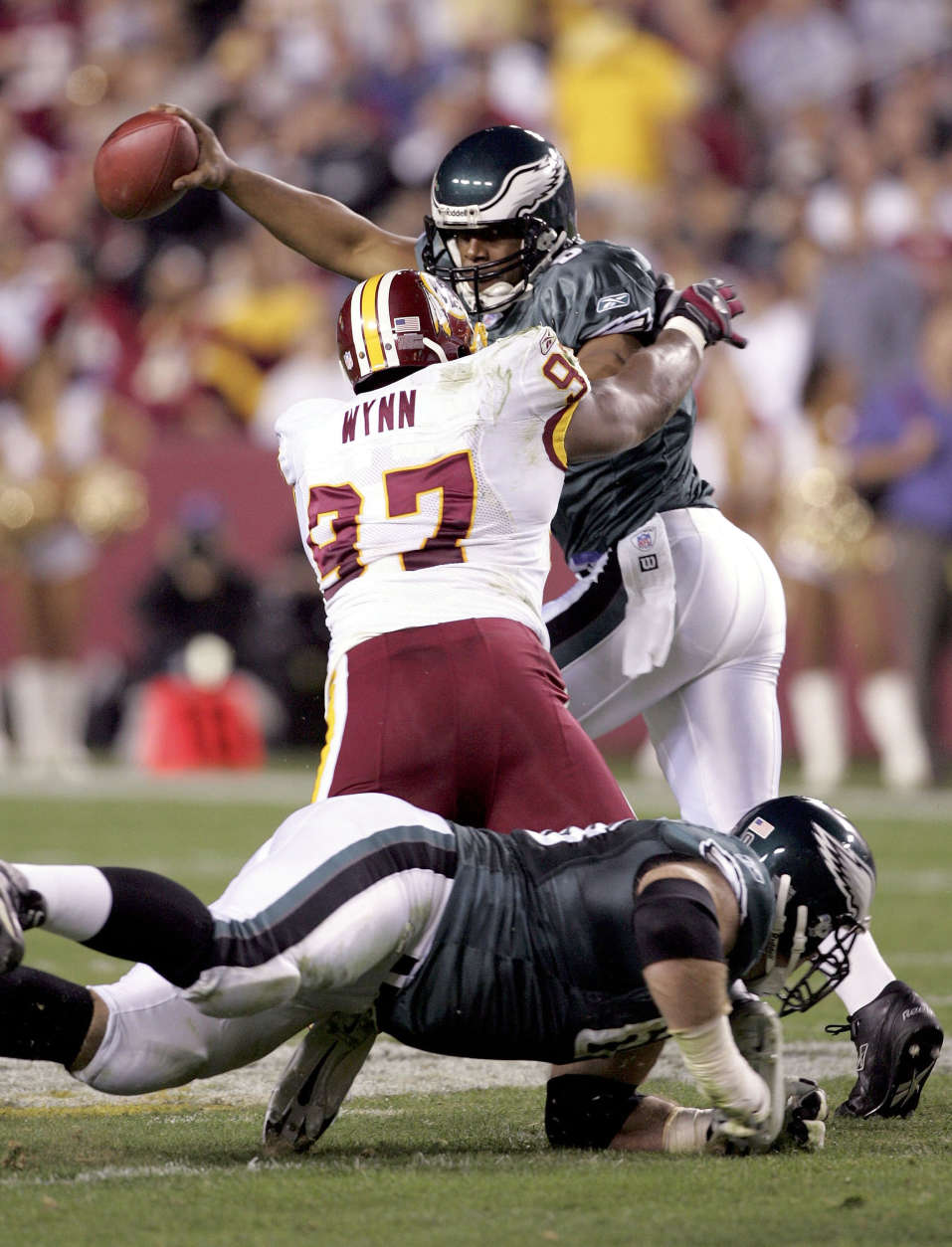 LANDOVER, MD - NOVEMBER 6:  Quarterback Donovan McNabb #5 of the Philadelphia Eagles scrambles under pressure from defensive end Renaldo Wynn #97 of the Washington Redskins on November 6, 2005 at FedEx Field in Landover, Maryland.  (Photo by Jim McIsaac/Getty Images)