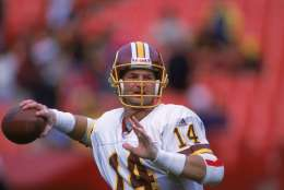 3 Dec 2000:  Brad Johnson #14 of the Washington Redskins lines up a pass during the game against the New York Giants at the FedEx Field in Landover, Maryland. The Giants defeated the Redskins 9-7.Mandatory Credit: Jamie Squire  /Allsport