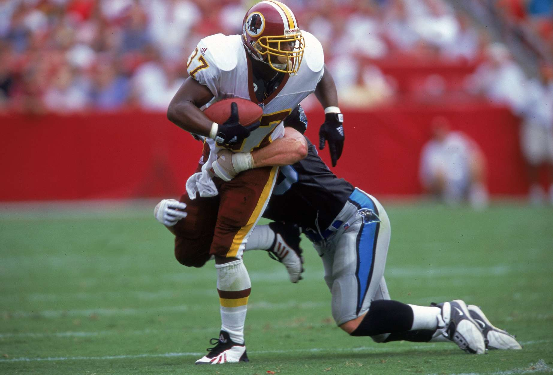 3 Sep 2000: Larry Centers #37 of the Washington Redskins tries to get out of a tackle during a game against the Carolina Panthers at FedEx Field in Landover, Maryland..  The Redskins defeated the Panthers 20-17.Mandatory Credit: Ezra O. Shaw  /Allsport