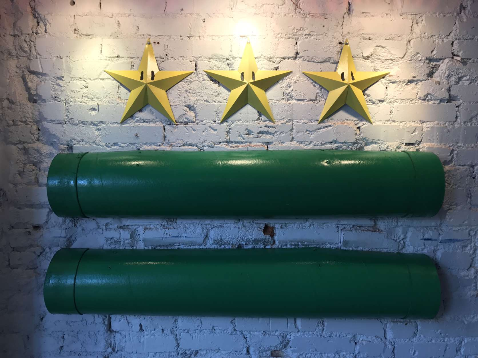 Inside the Mario Brothers bar, designers used the pipes and stars of the video game to create the image of the D.C. flag. (WTOP/Megan Cloherty)
