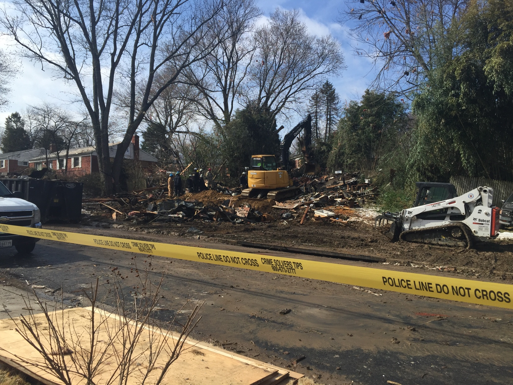 Caution tape surrounds the scene where a home exploded Friday in Rockville, Md. (WTOP/Dennis Foley)
