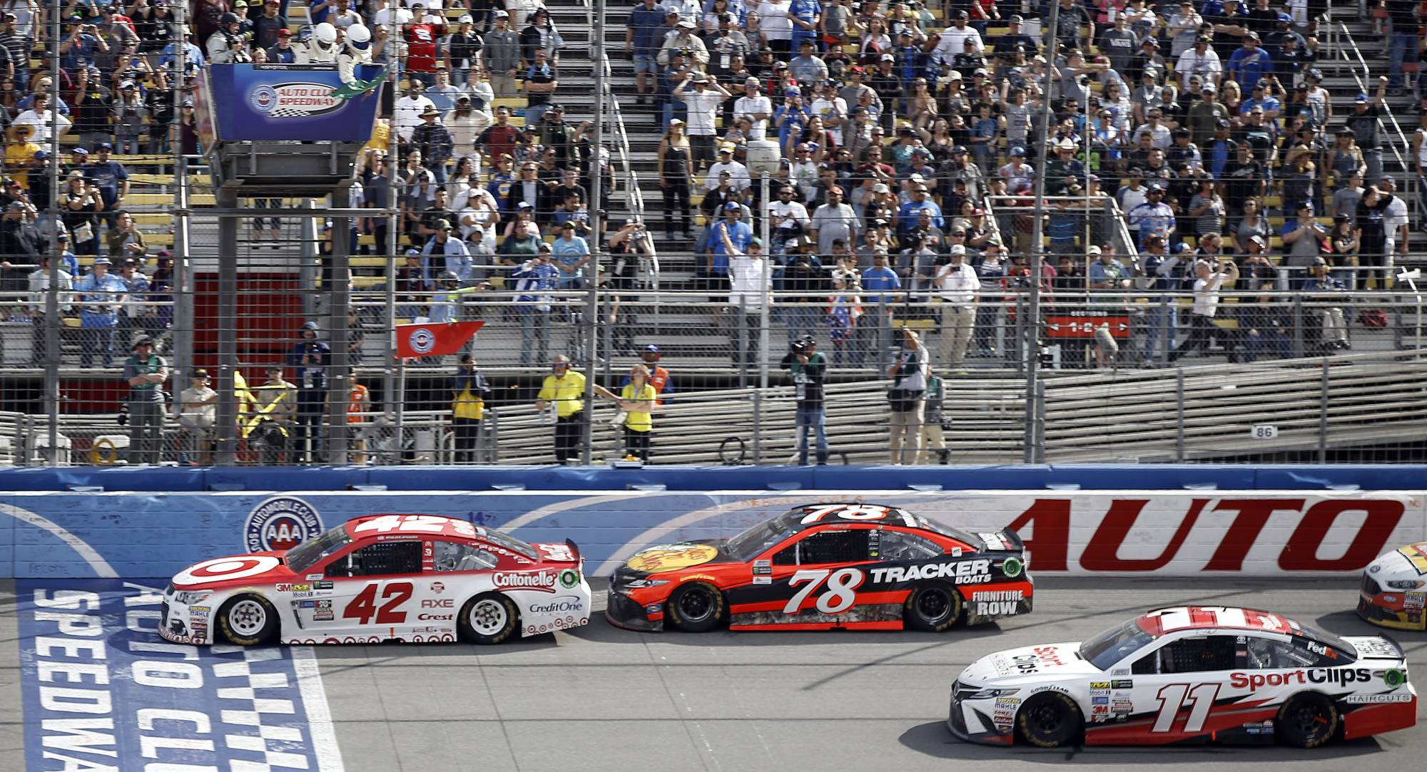 Larson completes weekend sweep, wins Auto Club 400