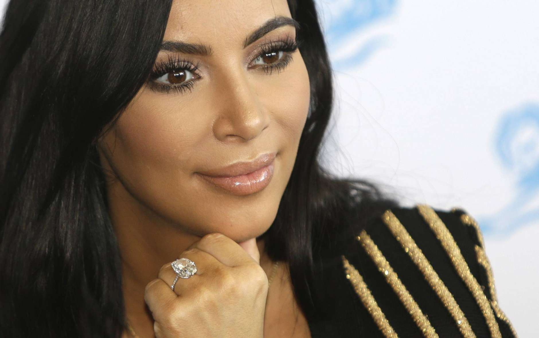 """FILE - In this June 24, 2015 file photo, American TV personality Kim Kardashian attends the Cannes Lions 2015, International Advertising Festival in Cannes, southern France. Kardashian discussed her experience being held at gunpoint during a Paris jewelry heist last year during an episode of E!'s """"Keeping Up with the Kardashians"""" that aired on Sunday, March 19, 2017. (AP Photo/Lionel Cironneau, File)"""