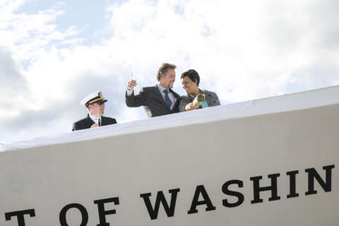 Mayor Bowser christens The Wharf's new yacht