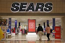 "FILE - In this Wednesday, Feb. 8, 2017, file photo, shoppers walk into a Sears store in Pittsburgh. Sears said that there is ""substantial doubt"" that it will be able to remain in business. The company, which runs Kmart and its namesake stores, has struggled for years with weak sales. (AP Photo/Gene J. Puskar, File)"