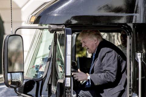 Trump climbs into 18-wheeler, pretends to be trucker
