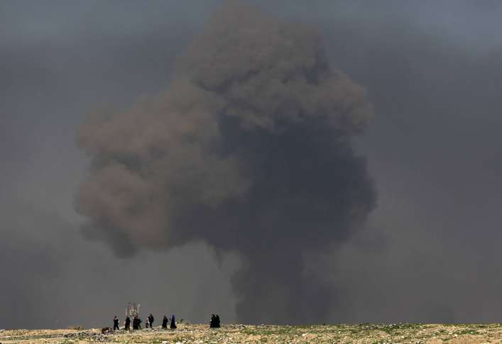 Backed forces battle for Islamic State-held air base in Syria
