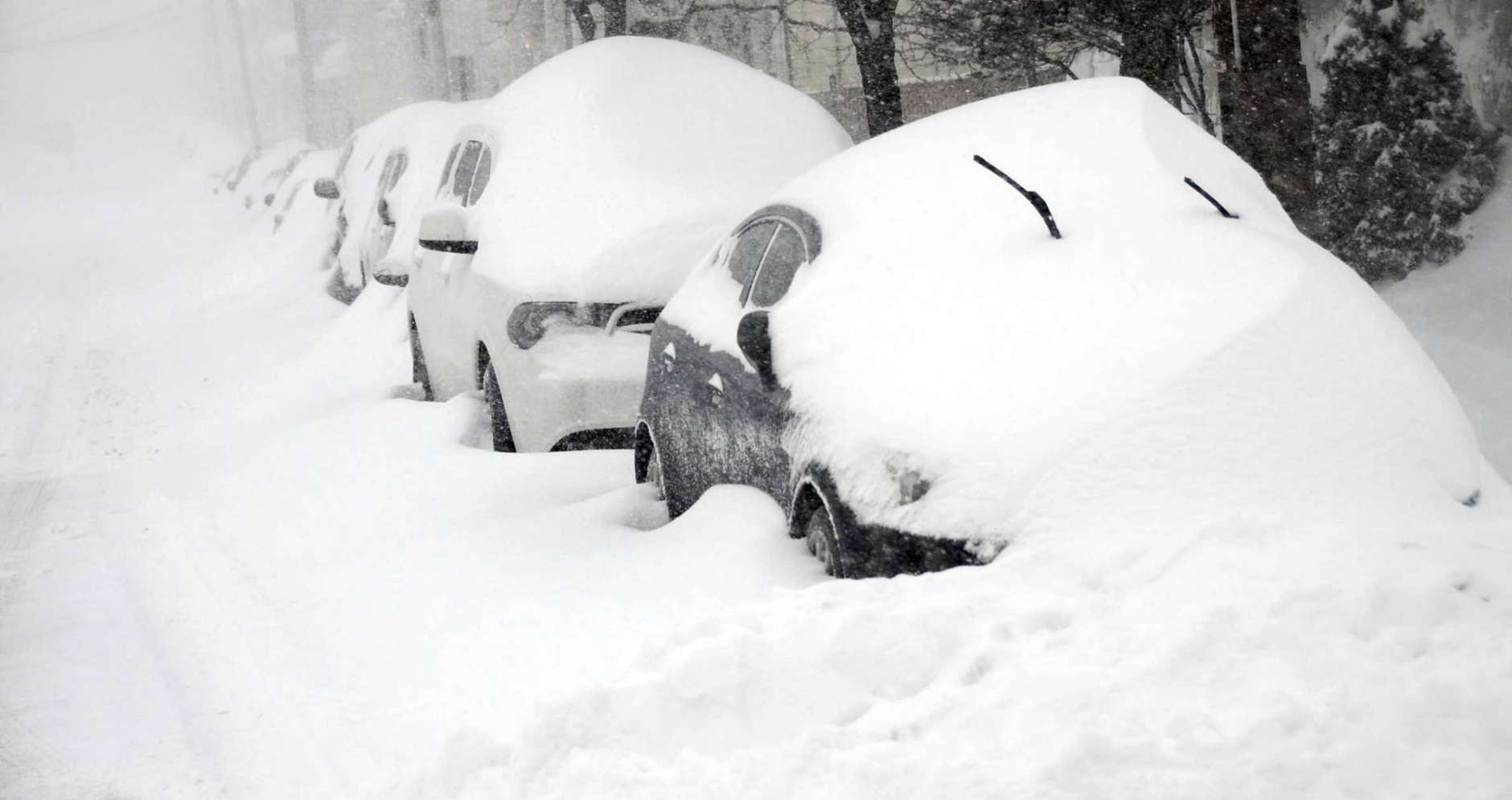 Cars parked on East Green Street in Hazleton, Pa., are buried as heavy snowfall moves through the area leaving more than a foot of snow, Tuesday, March 14, 2017. More than 30 inches of snow is expected to accumulate before the winter storm moves out. (Ellen F. O'Connell/Hazleton Standard-Speaker via AP)