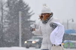 Linde Lopez fights wind gusts as she crosses the Bayfront Parkway on her way to her job as an oncology nurse at UPMC Hamot in Erie, Pa., on Tuesday, March 14, 2017. (Christopher Millette/Erie Times-News via AP)