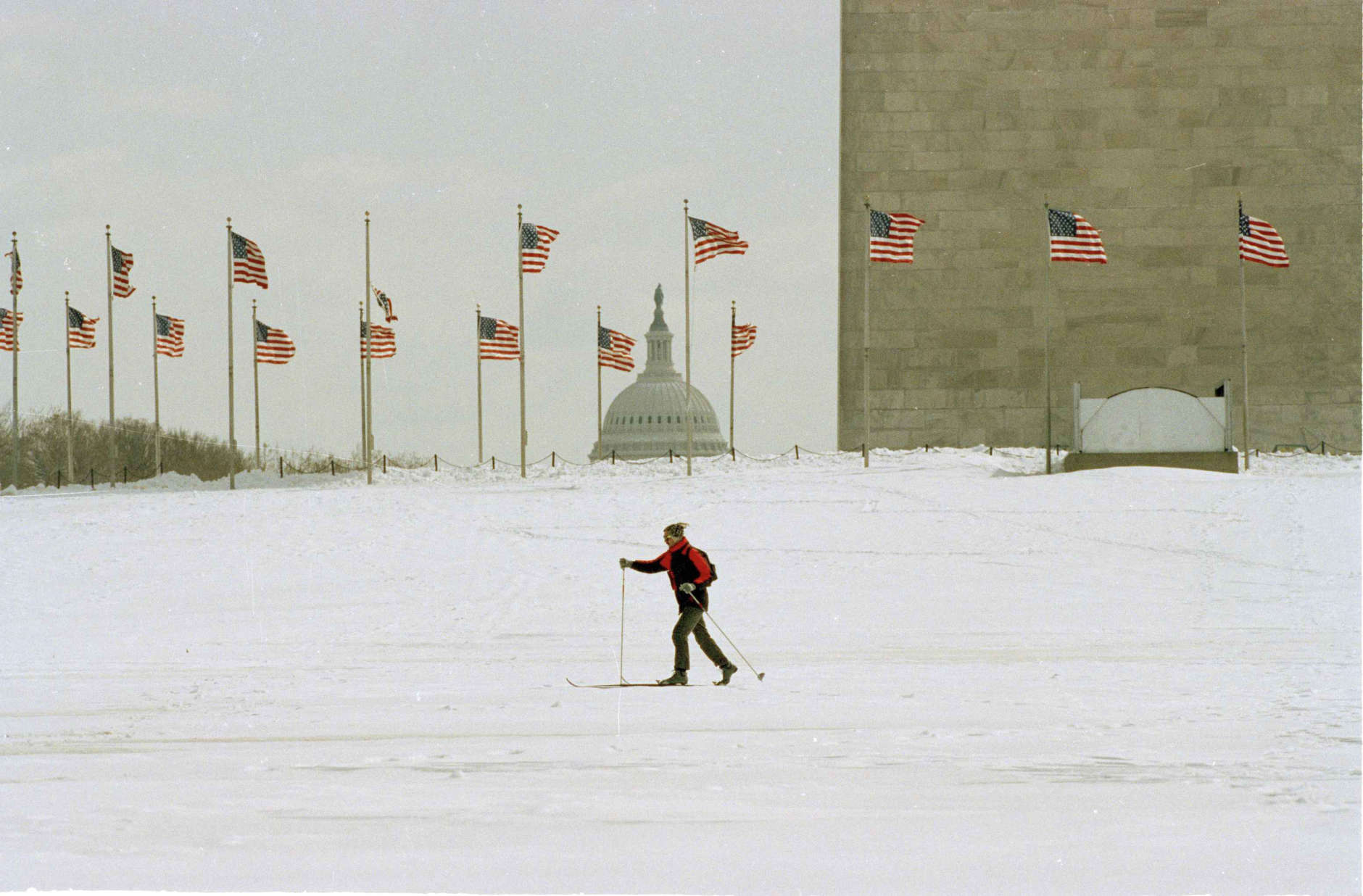 A lone skier crosses the Mall in front of the Washington Monument, March 14, 1993. Much of downtown Washington was deserted Sunday morning as they city began to recover from one of the biggest winter storms in recent years. (AP Photo/Doug Mills)
