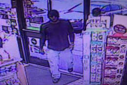 D.C. detectives seek the public's help in identifying and locating this person of interest in connection with the death of Corrina Mehiel. The photo was taken in the 5000 block of Garrett Avenue in  Beltsville, Maryland. (Photo courtesy D.C. police)