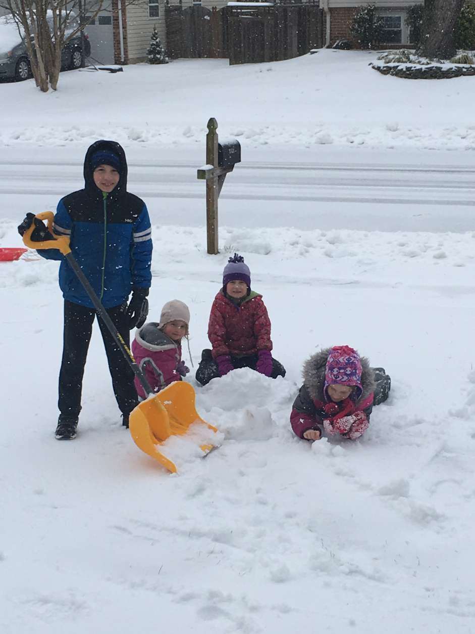 Children, too, can follow safe shoveling practices. (Courtesy Robert Muskett)