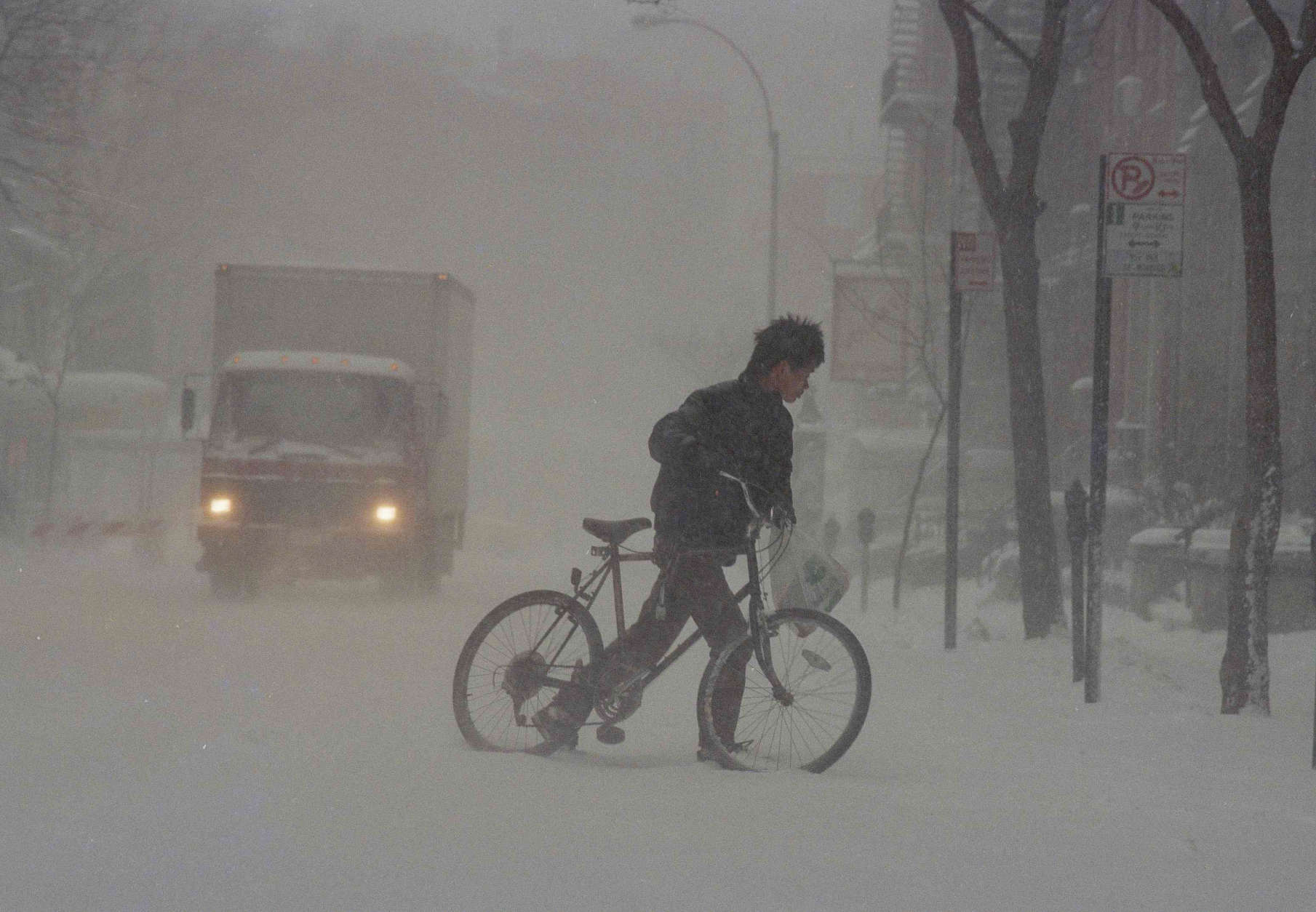 A cyclist makes his way across a New York street  March 13, 1993. The storm that dumped 13.9 inches of snow at Dulles International Airport enveloped the eastern third of the country. (AP Photo/Robert Clark)