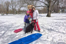 Scout, Virginia 9 and Elizabeth 12 her sister take a sledding break (WTOP/Dick Uliano)