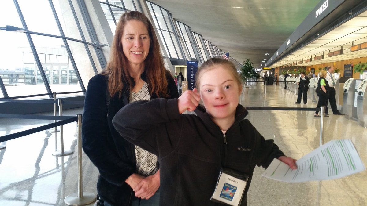 11-year-old Kelsey DaRae was excited to her her boarding pass for the simulated flight to Baltimore. (WTOP/Kathy Stewart)