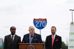 """Maryland Gov. Larry Hogan (center) outlined his $100 million plan to ease congestion on Interstate 270 in Montgomery County. He was joined by Montgomery County Executive Isiah """"Ike"""" Leggett (left) and Maryland State Highway Administration Greg Slater. (WTOP/Kate Ryan)"""
